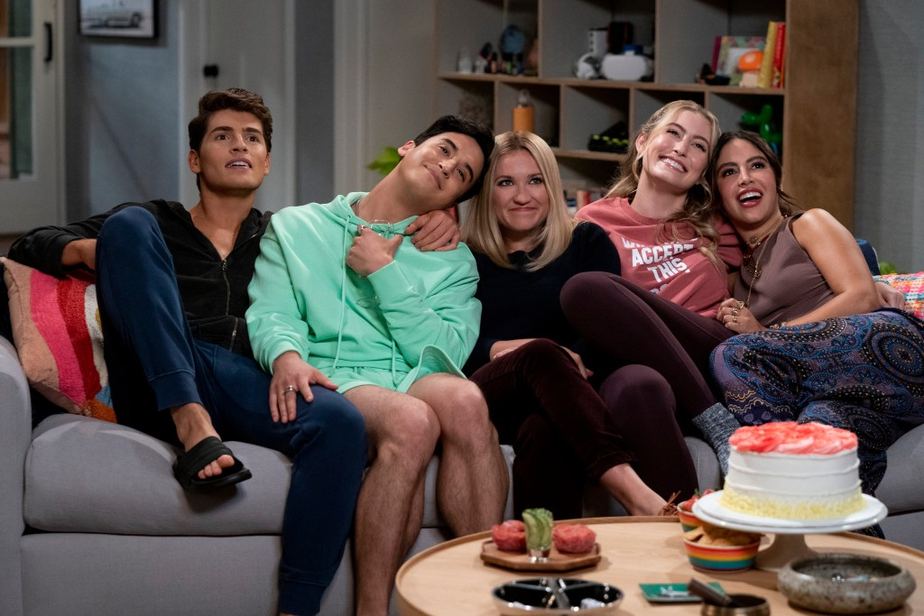New roommates sit in a row snuggling on a couch: Grant (Gregg Sulkin), left, Jayden (Michael Hus Rosen), Chelsea (Emily Osment), Claire (Olivia Macklin) and Solana (Cinthya Carmona).