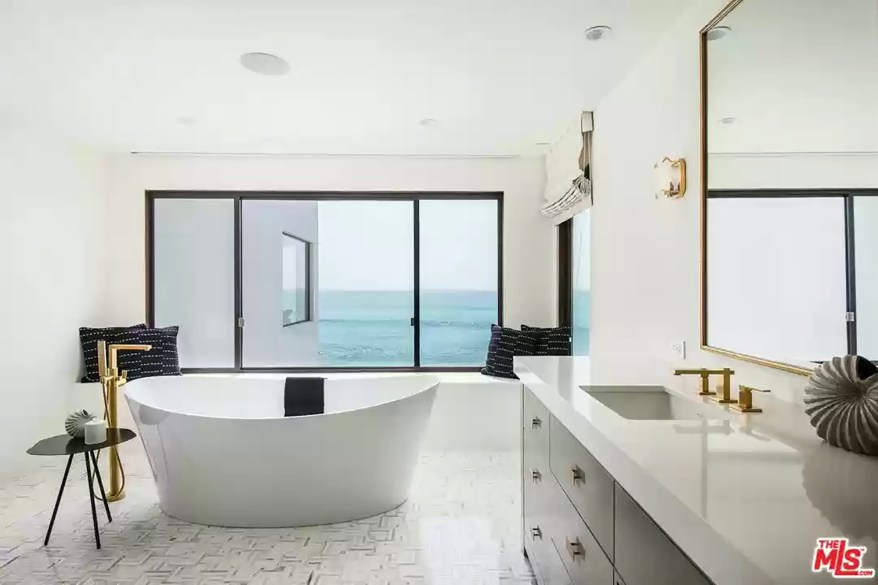 A bathroom with a standalone tub is pictured.