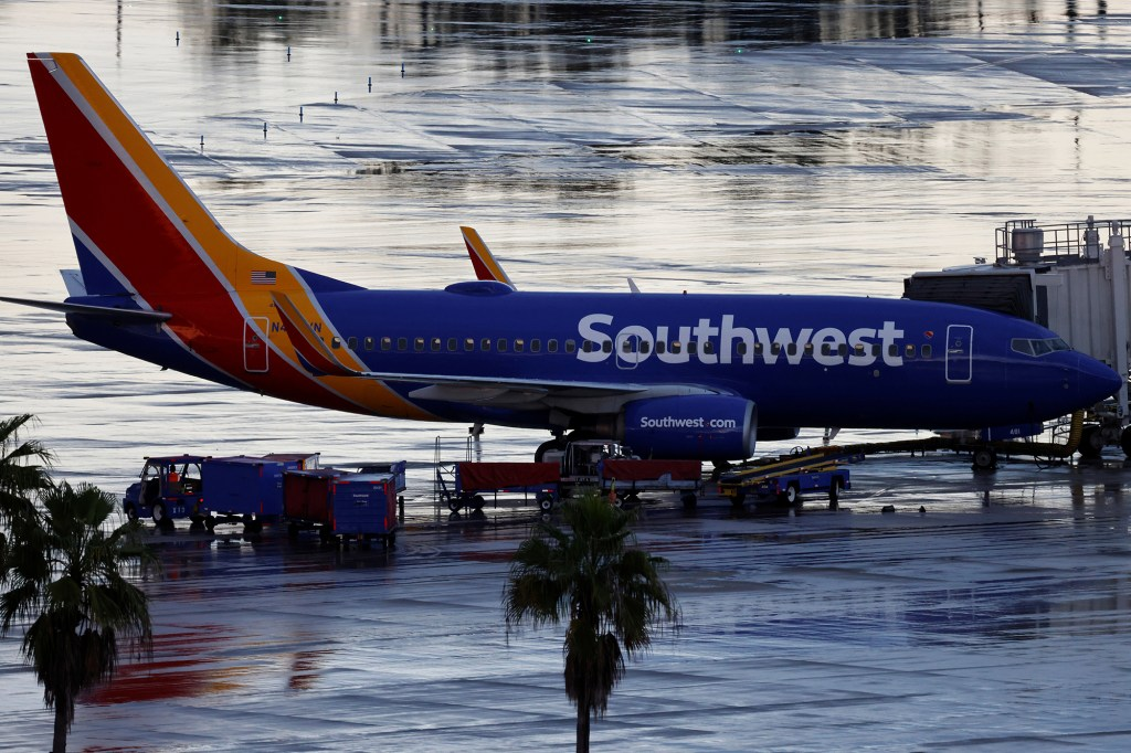 A Southwest Airlines jet sits at a gate at Orlando International Airport in Orlando, Florida.