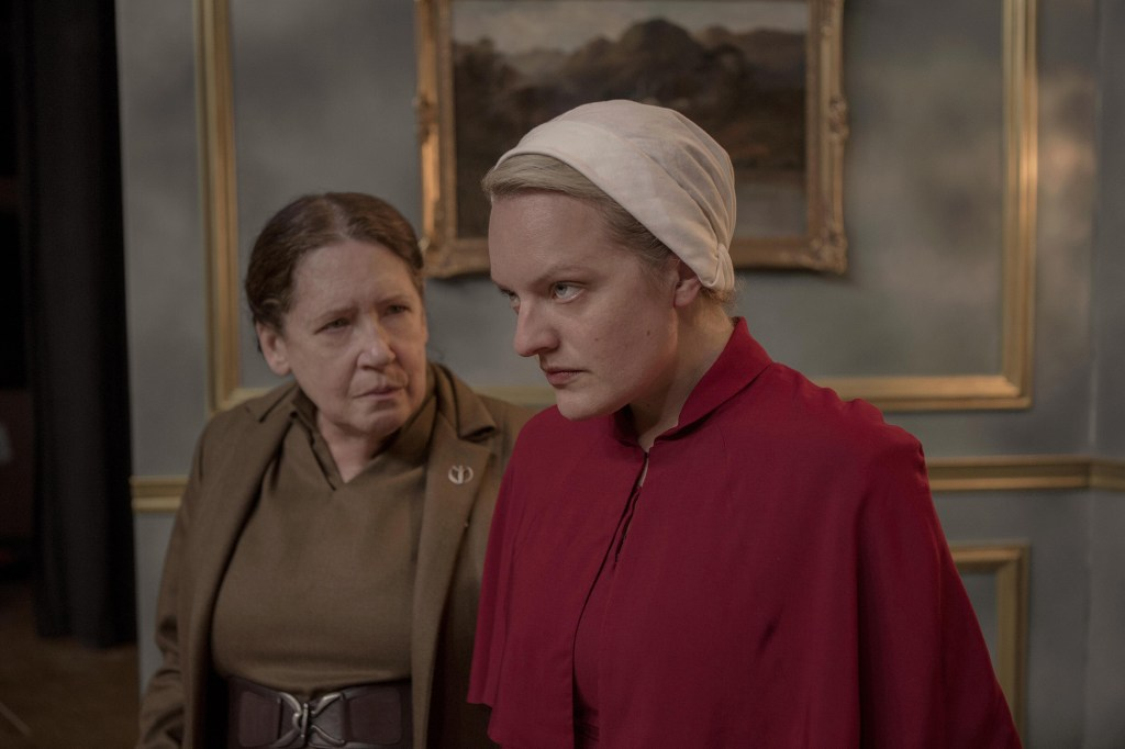 """Photo showing a scene from """"The Handmaid's Tale"""" with Ann Dowd and Elisabeth Moss as Aunt Lydia and June, who's wearing her handmaid's uniform."""