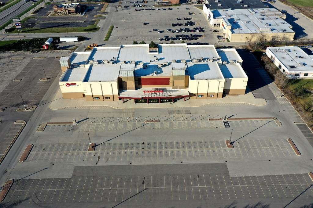 In an aerial photo shot with a drone an empty parking lot is seen in front of a Cinemark theater shuttered by the coronavirus COVID-19 on December 04, 2020 i