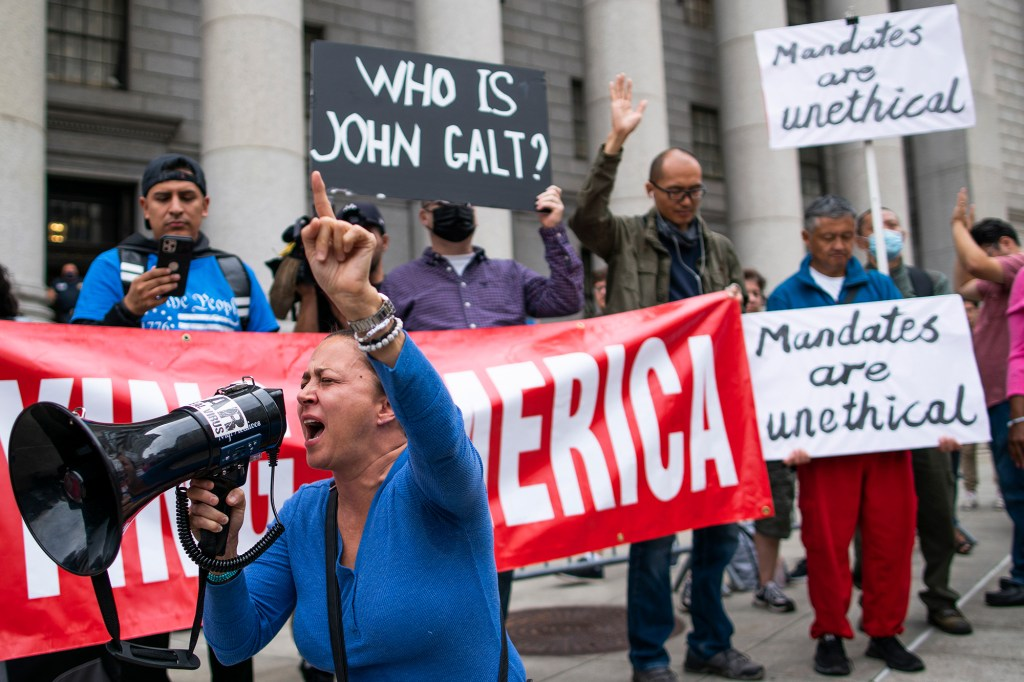 Teachers and protesters demonstrate against COVID-19 vaccine mandates outside the Manhattan Federal Court on October 12, 2021.