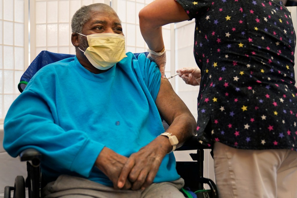 Edward Williams, 62, a resident at the Hebrew Home at Riverdale, receives a COVID-19 booster shot in New York, Monday, Sept. 27, 2021.