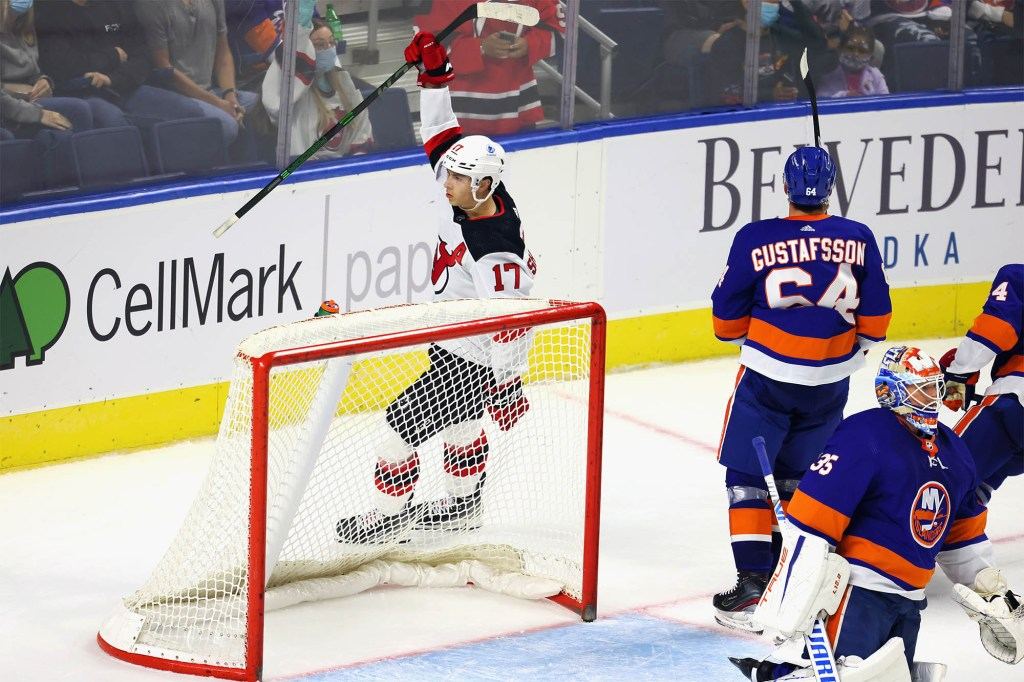 Yegor Sharangovich celebrates his game-winning goal for the Devils.