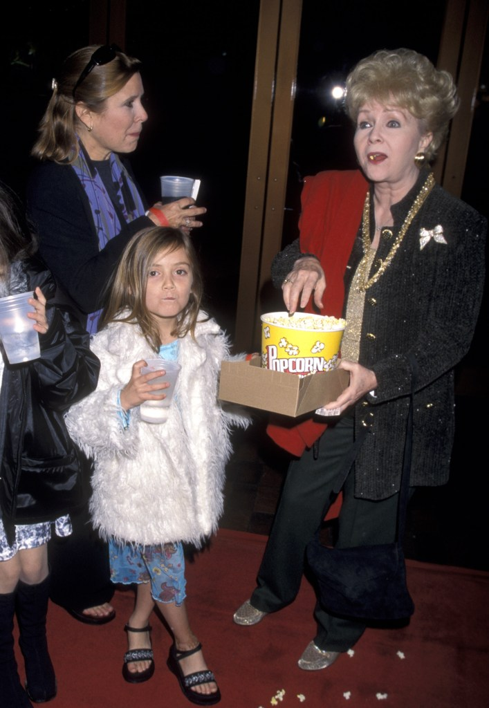 Fisher and Reynold are seen with a younger Lourd at a movie premiere in 1999