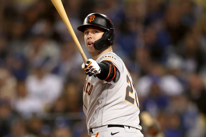 Buster Posey of the San Francisco Giants gets rid of his bat after striking out during Game 3 of the NLDS.