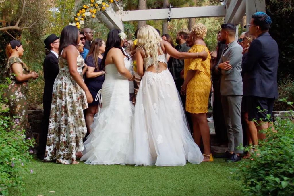 """After saying """"I Do"""" Herbert and Taylor were greeted by their cheering wedding guests."""