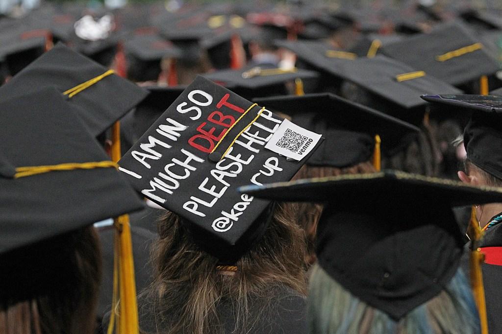 Debt sign on a graduation cap.
