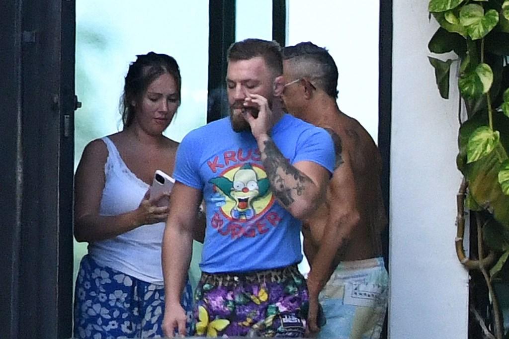 conor mcgregor smokes a hand-rolled cigarette in miami
