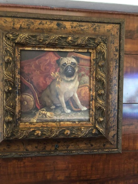 A pug portrait makes adds to the home-y feeling.