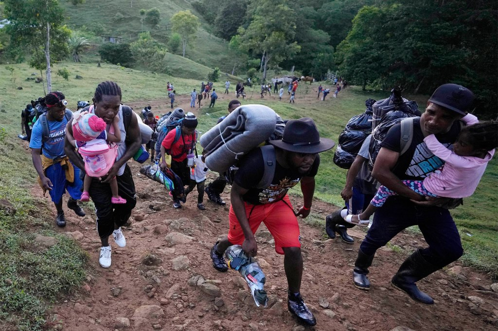 Migrants continue their trek through Colombia on Sept. 15, 2021.