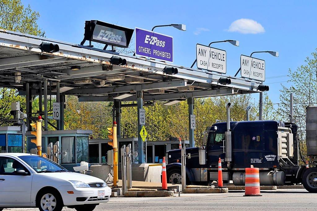 On Thursday, May 16, 2013, tolls at Exit 6 were busy with traffic, many using the E-ZPass and others paying with cash.