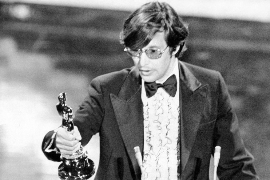 """William Friedkin stares at his best director Academy Award for """"The French Connection."""""""