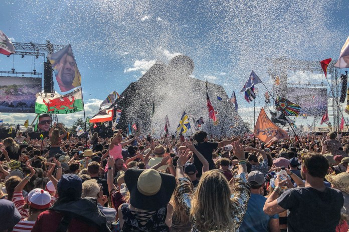 A crowd listens to performers at the Glastonbury Festival on June 30, 2019.