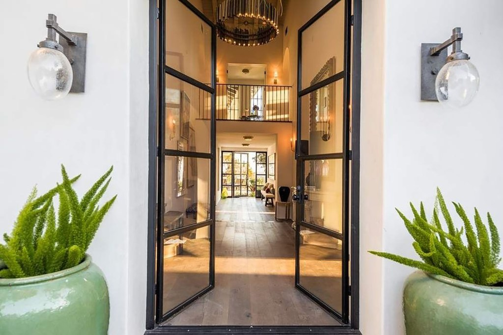 Oversized glass front doors open to the foyer.
