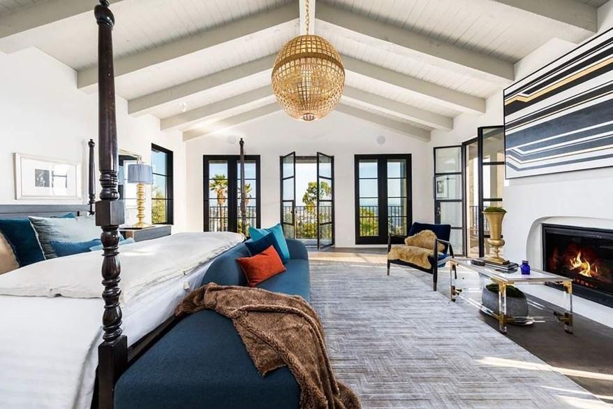 This bedroom has peaked, beamed ceilings.