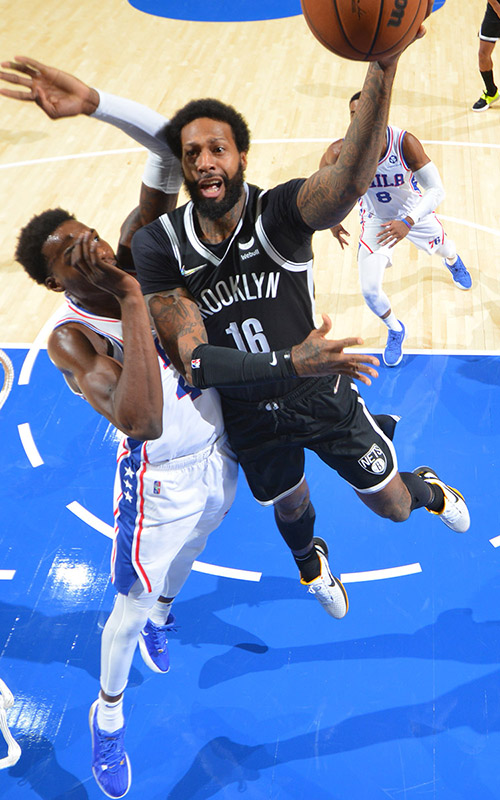 James Johnson #16 of the Brooklyn Nets looks on against the Philadelphia 76ers at the Wells Fargo Center on October 11, 2021