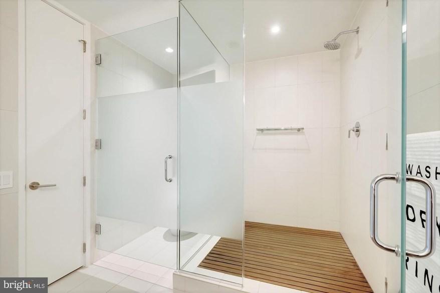 The primary bathroom boasts a rain shower.