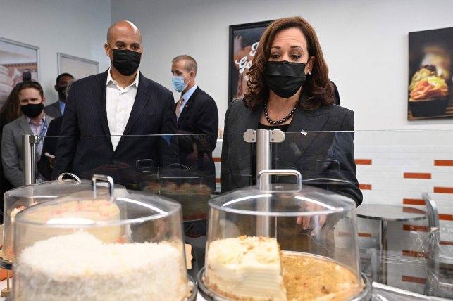 Senator Corey Booker (left) accompanied Vice President Harris on a visit to the bakery.
