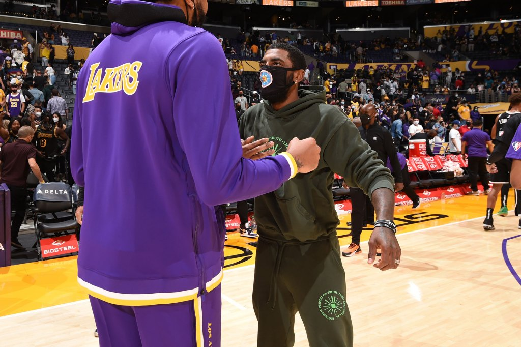 Anthony Davis #3 of the Los Angeles Lakers talks with Kyrie Irving #11 of the Brooklyn Nets