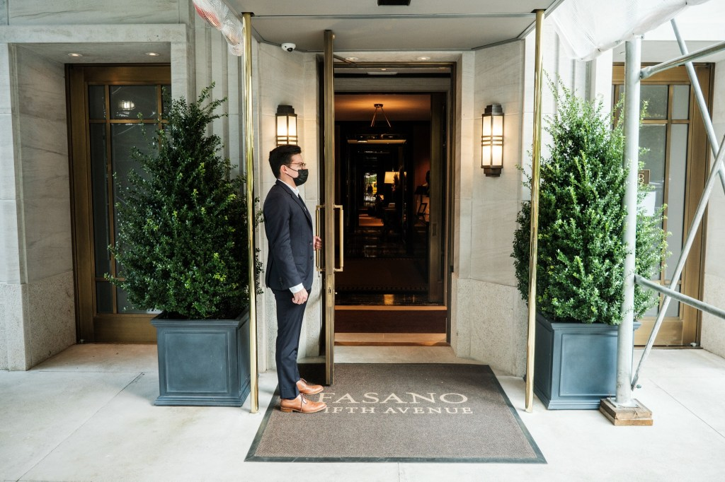 An exterior of a doorman at the entrance to Fasano.