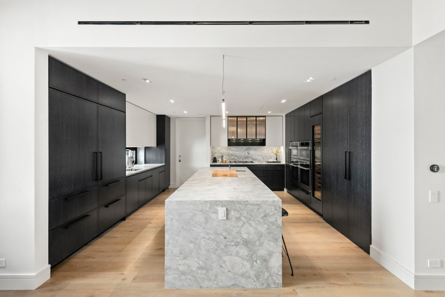 The kitchen has black cabinetry.