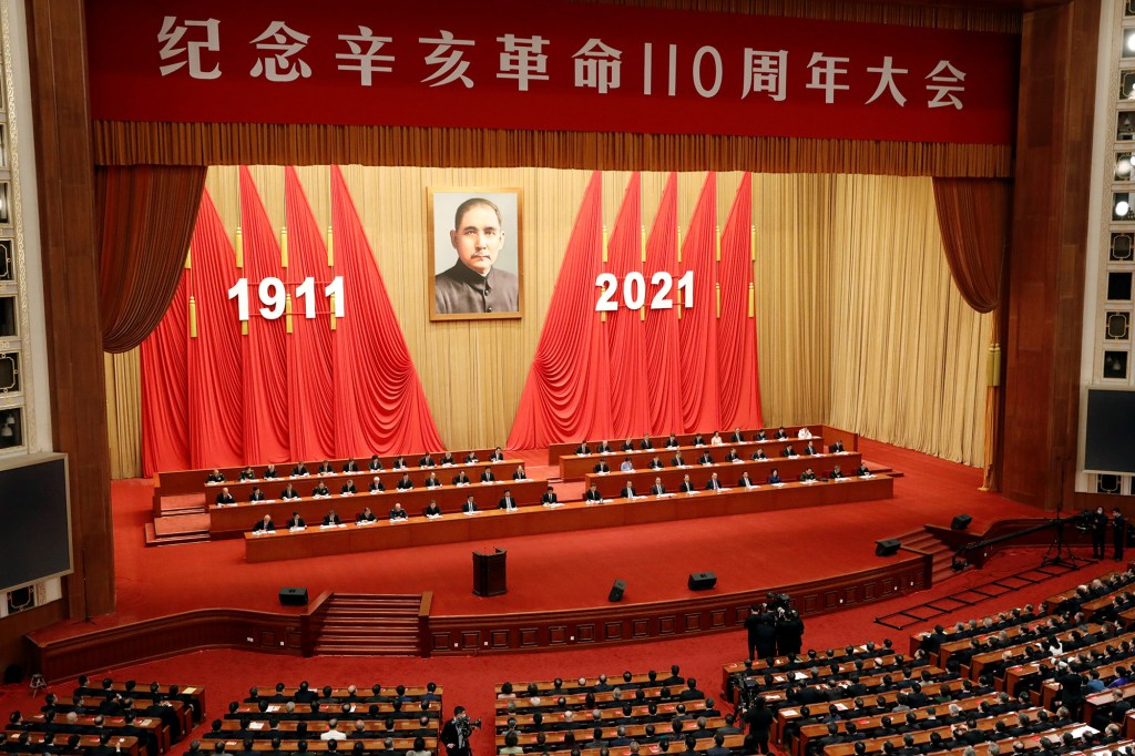 A giant portrait of Sun Yat-sen hangs above Chinese President Xi Jinping and other leaders attending a meeting commemorating the 110th anniversary of Xinhai Revolution at the Great Hall of the People in Beijing, China October 9, 2021.