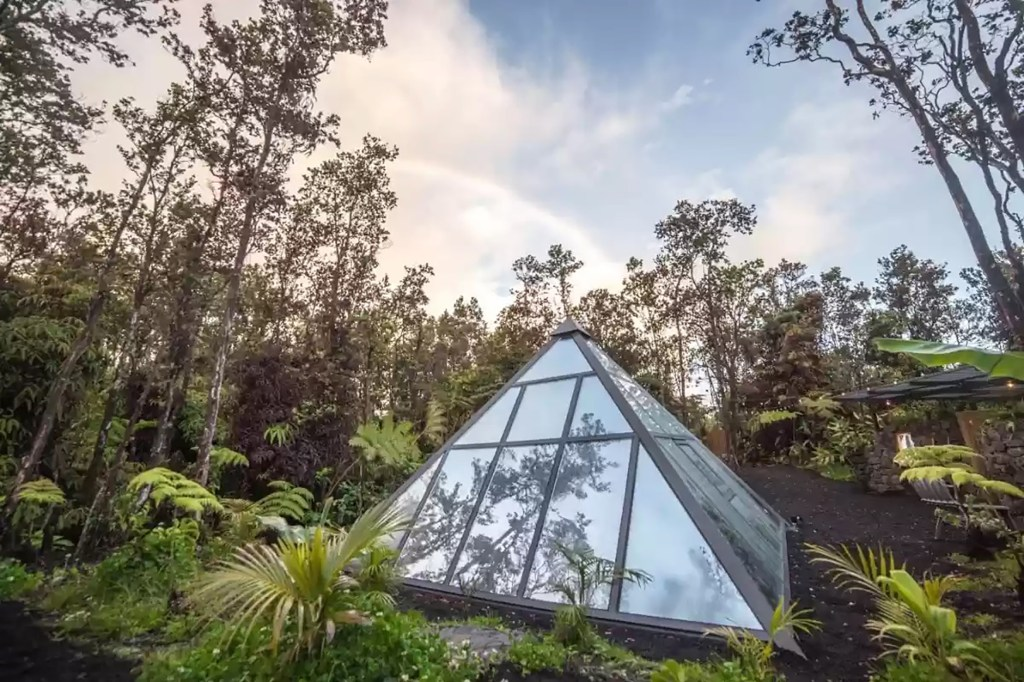 The pyramid home is made up of double-glazed glass walls held together with a sturdy and modern functional metal frame.