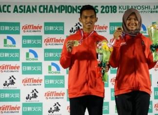 Atlet panjat tebing Merah Putih, Alfian M. Fajri (kiri), dan Agustina Sari, jadi kampiun nomor speed world record perorangan putra dan putri, di Asian Championship 2018, di Kurayoshi, Prefecture Tottori, Jepang, pada Sabtu (10/11). (FPTI)