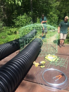 The deceivers, trapezoidal and pond leveling were completely constructed on land before they were placed into the water, photo by Lilly Schelling.