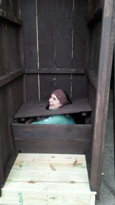 Marlena testing out one of the outhouses, photo by Michaela Aney