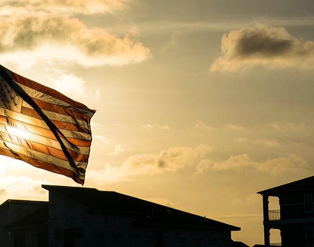 school flag at half mast to acknowledge school shooting