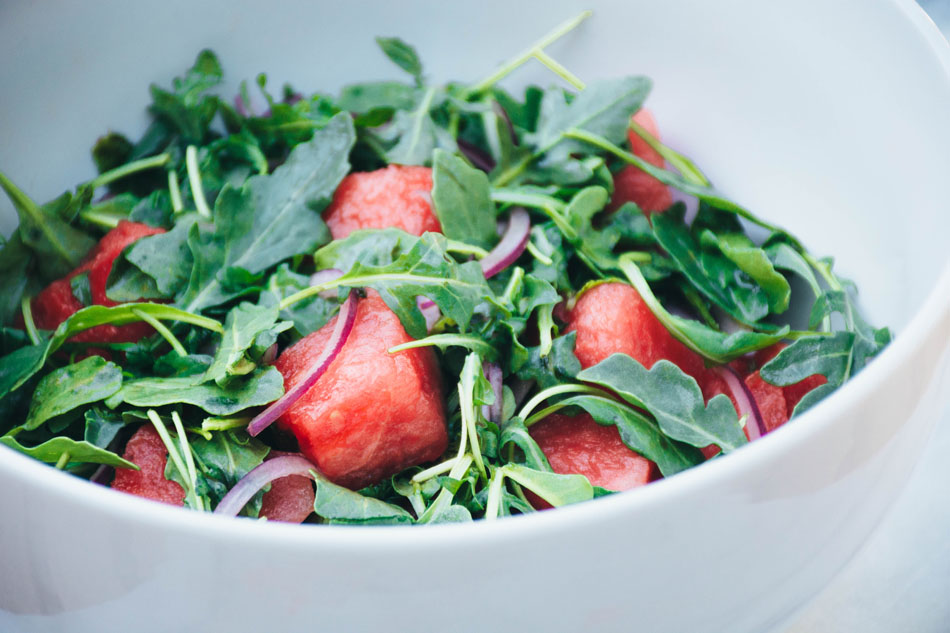 watermelon arugula salad with mint and red onion - a super easy and healthy salad made with juicy watermelon, red onion, fresh mint, arugula and a simple lime vinaigrette. the perfect summer salad!   www.nyssaskitchen.com