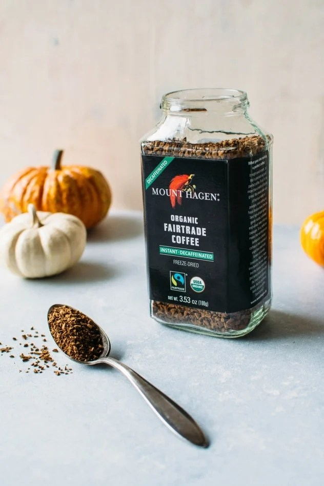 Instant coffee for paleo iced pumpkin spice latte - a dairy free and healthier version of everyone's favorite seasonal drink! Made with real pumpkin and sweetened with maple syrup. Top with coconut whipped cream for the ultimate treat!