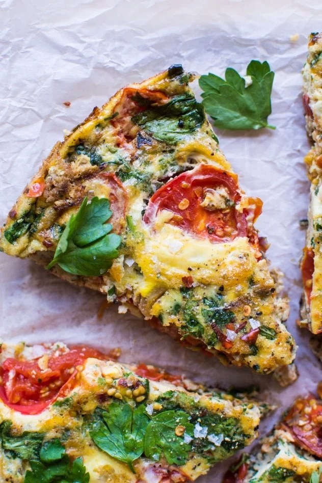 This late summer frittata with tomatoes and fresh herbs has been my go-to egg dish pretty much since it's been warm enough to wear sandals! Made with good-for-you pasture raised eggs, ripe summer tomatoes, savory caramelized shallots, spinach, and fresh parsley for some seriously delicious flavor - it's a must try!