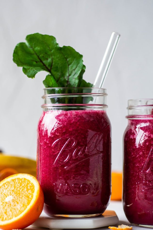 This beet and berry smoothie is made with 5 healthy & vibrant ingredients that will make you glow from the inside out. Vegan, paleo friendly, and whole30 compliant - it's a crazy delicious way to start your day with a healthy dose of both fruit and veggies!