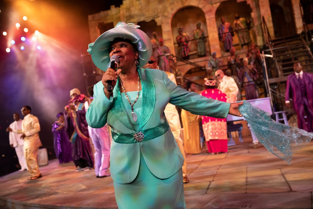 <I> Carolyn Johnson-White leads the ensemble in The Gospel at Colonus. Photo: Joan Marcus</I>