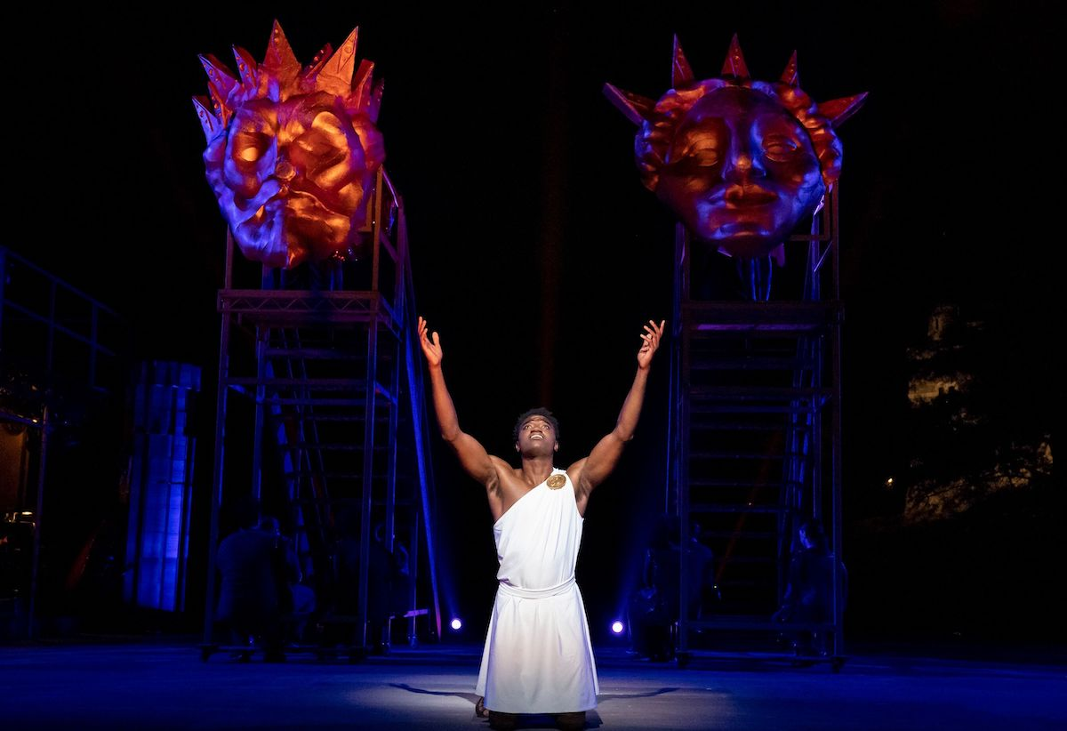 Hercules: The Strong Man and Huge Cast Sing Lustily on Stage
