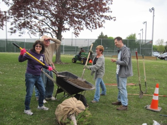 Volunteers prep to plant a weeping larch