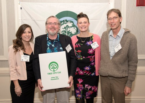 Woodstock Tree Committee Chair Michael Veitch celebrated Woodstock's first year as a Tree City USA with Mary Marin, George Profous, and Sally Kellogg.