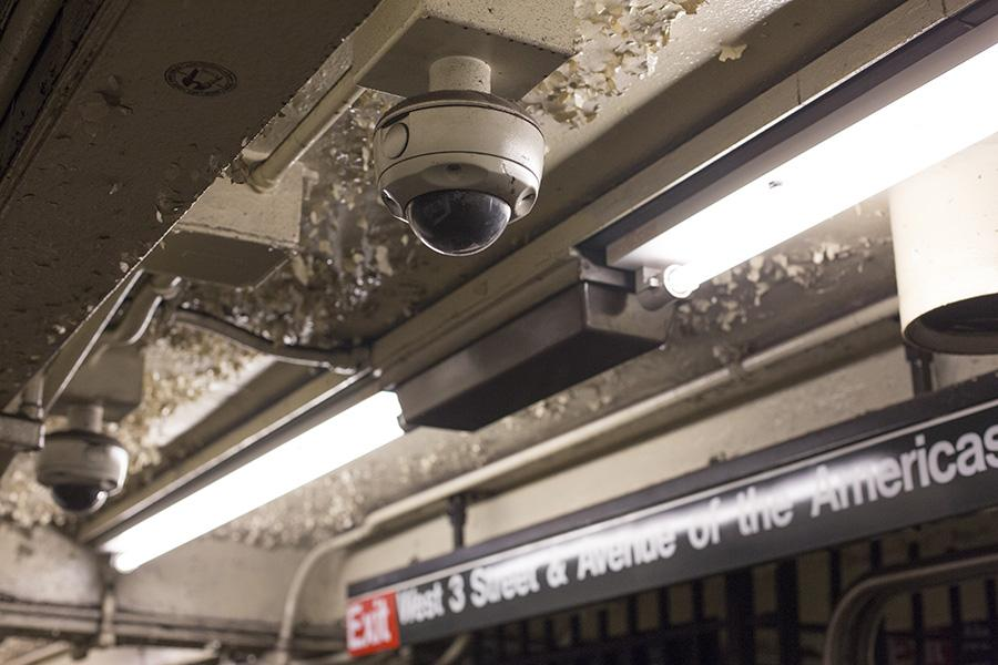 Rows of surveillance cameras line the ceiling at the West Fourth street MTA station.