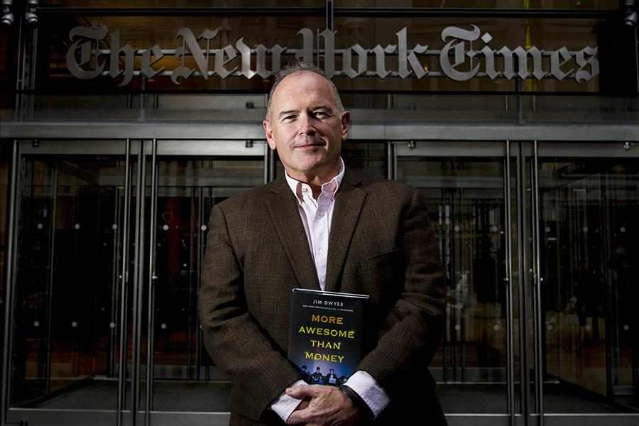 Columnist Jim Dwyer stands in front of the New York Times building with his new book,