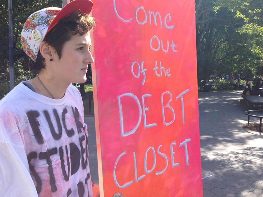 AJ Jonathan stands by the debt closet door in Washington Square Park on Wednesday.