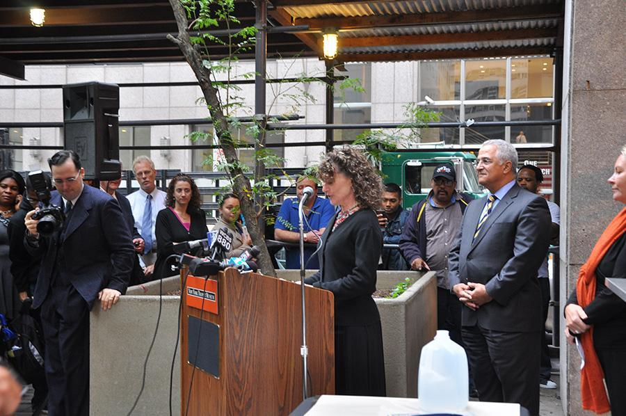 Gabrielle Shubert, director of the New York City Transit Museum, welcomes the crowd to the unveiling of the time capsule.