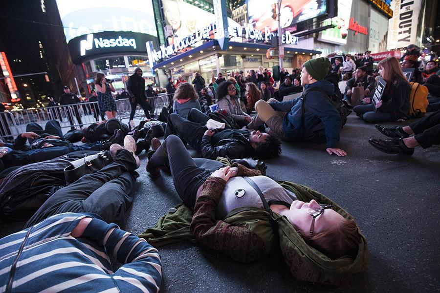Protesters sit down in Times Square.