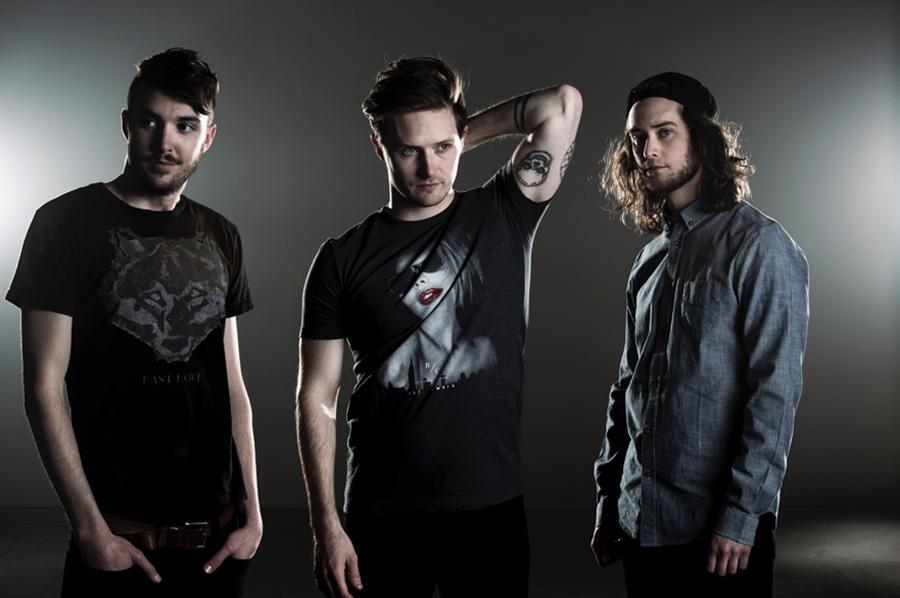 Chris Duggan, center, is the lead guitarist and vocalist of PLAID BRIXX, which he founded in 2013.