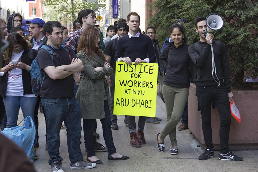 Protesters rally outside of Bobst for the compensation of Abu Dhabi workers affected by labor rights violations on Friday.