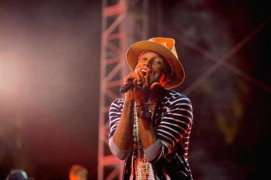 Pharrell, shown performing at the 2014 Coachella Valley Music and Arts Festival, will be an artist-in-residence at NYU's Tisch School of the Arts this year.