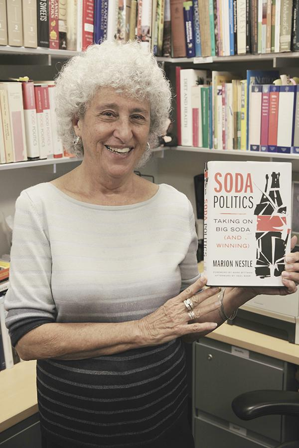 Marion+Nestles+showcases+her+new+book+%E2%80%9CSoda+Politics%3A+Taking+on+Big+Soda+%28and+Winning%29%E2%80%9D+in+her+office.+%0A