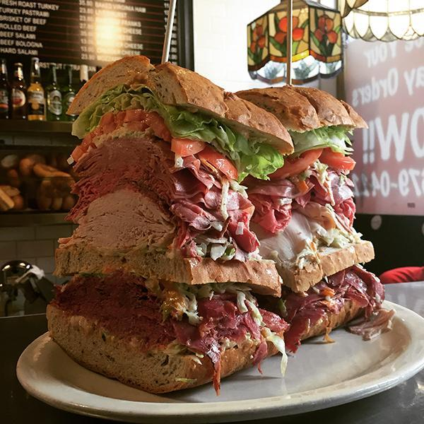 On 3rd and 37th Street, Sarge's Deli offers a monster sandwich topped with Corned Beef, Pastrami, Roast Beef, Fresh Turkey, Salami, Sliced Tomato, Lettuce, Cole Slaw & Russian Dressing, weighing 4.5 pounds.